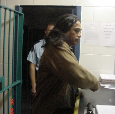 Cassidy being processed at Kaikohe Police Station. Photo - R. Atkinson
